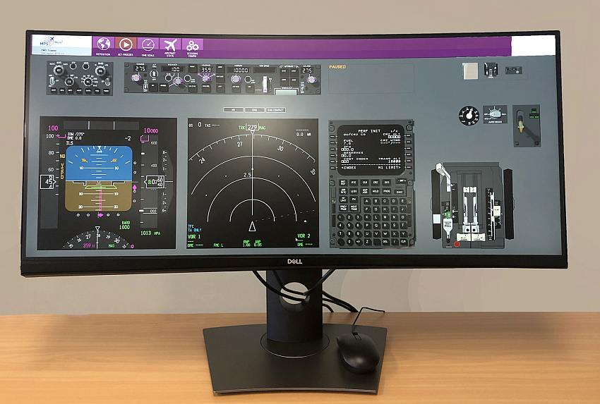 curved desktop computer screen with flight managemtn system training software